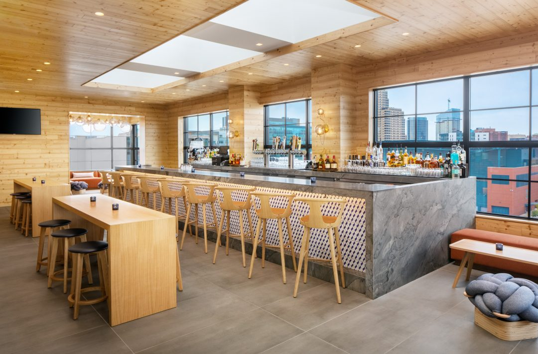 Bar with stools and a view out to the city